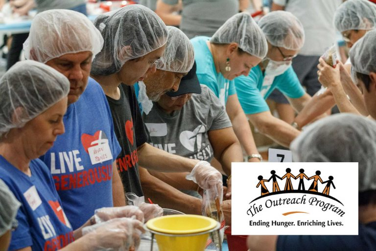 Volunteers packing food during pack-a-thon