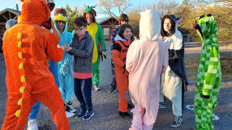 Middle and high school youth wearing onsies at a retreat